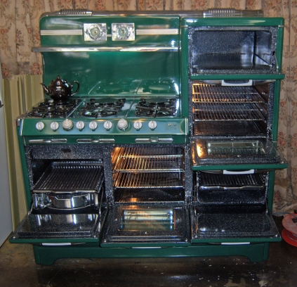 "Opened up Right Stack Warming Oven Oven Broiler below Center Oven Left side""Grillavator"" Left top 6 Burners"