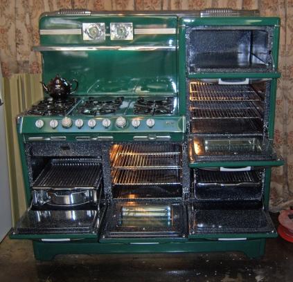 "Opened up Right Stack Warming Oven Oven Broiler below Center Oven Left side""Grillavator"" Left top 6 Burners"
