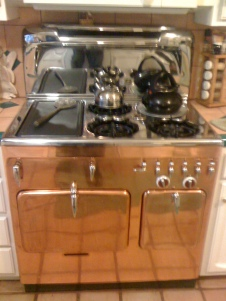 """Custom Copper"" with Chrome top and Back Splash Teflon Griddle on the left with Broiler underneath ""Soupwell"" on the right rear this one glows!"