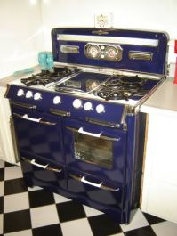 "1955 beautiful lines ""popping"" Cobalt Blue 38.5"" W x 28"" D cook-top 36"" H Fluorescent Light with Light Diffuser center ""Pancake"" Griddle Oven Window and Light Left side ""Grillavator"" Large adjustable Broiler Aux. Plugs"