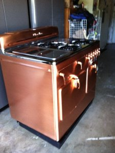 Copper with chrome top. Griddle top left, Soupwell top rear on right