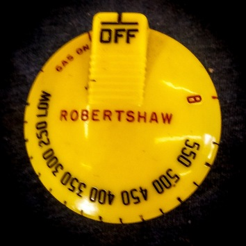 "O'Keefe & Merritt oven knob, yellow, 1"" shaft, $60."